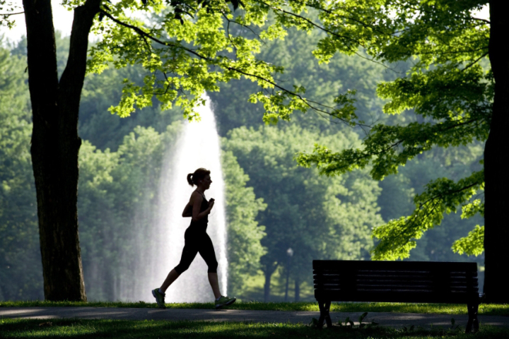 A woman jogs during the cool morning air in a downtown Montreal park Thursday, July 28, 2011 with daytime temperatures expected to hit the 30's C. THE CANADIAN PRESS/Paul Chiasson